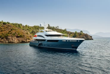 Luxury big yacht stay in the sea around the island on a background of the sky